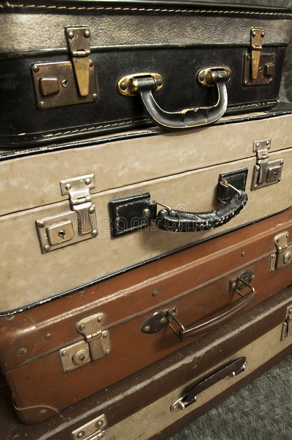 Vintage, aged suitcases on stack royalty free stock photography