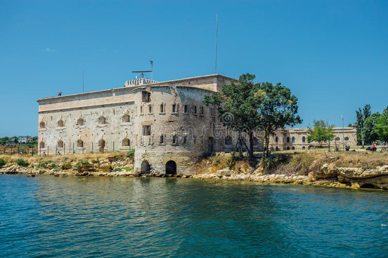 Old damaged by war fort in the Black Sea coast. Coastal Michael`s fortress in Sevastopol, Crimea.  stock photo