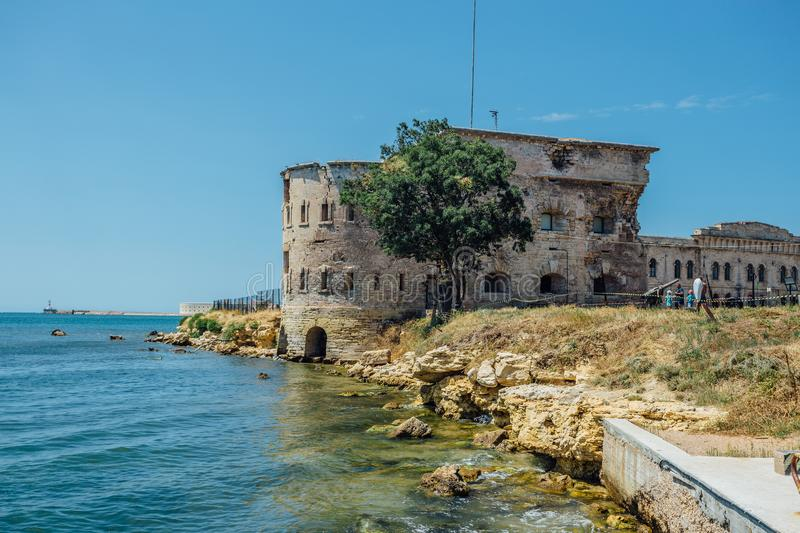 Old damaged by war fort in the Black Sea coast. Coastal Michael`s fortress in Sevastopol, Crimea.  stock image