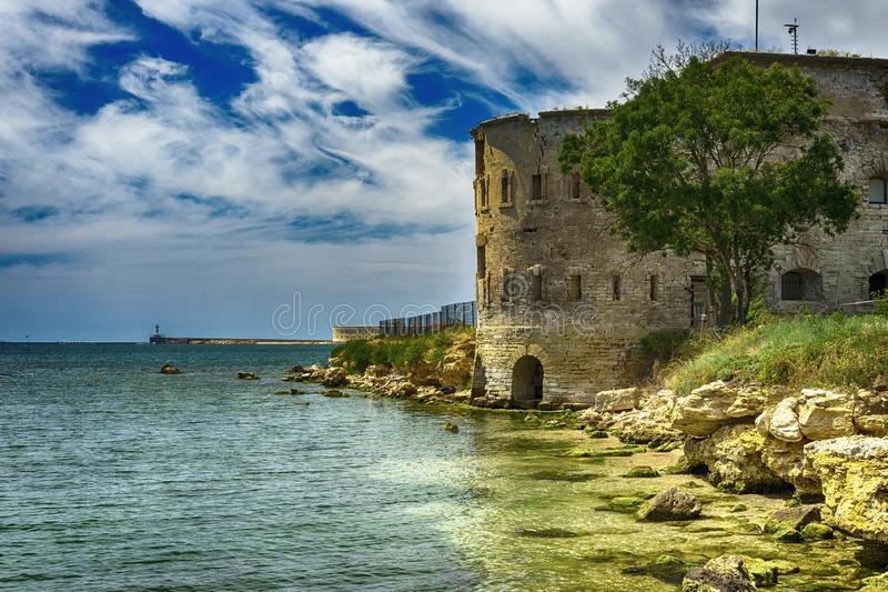 Old damaged by war fort in the Black Sea coast. Coastal Michael`s fortress in Sevastopol, Crimea. Stock photo stock photography