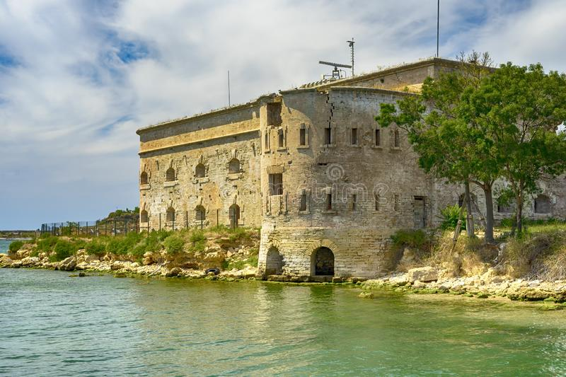 Old damaged by war fort in the Black Sea coast. Coastal Michael`s fortress in Sevastopol, Crimea. Stock photo royalty free stock image
