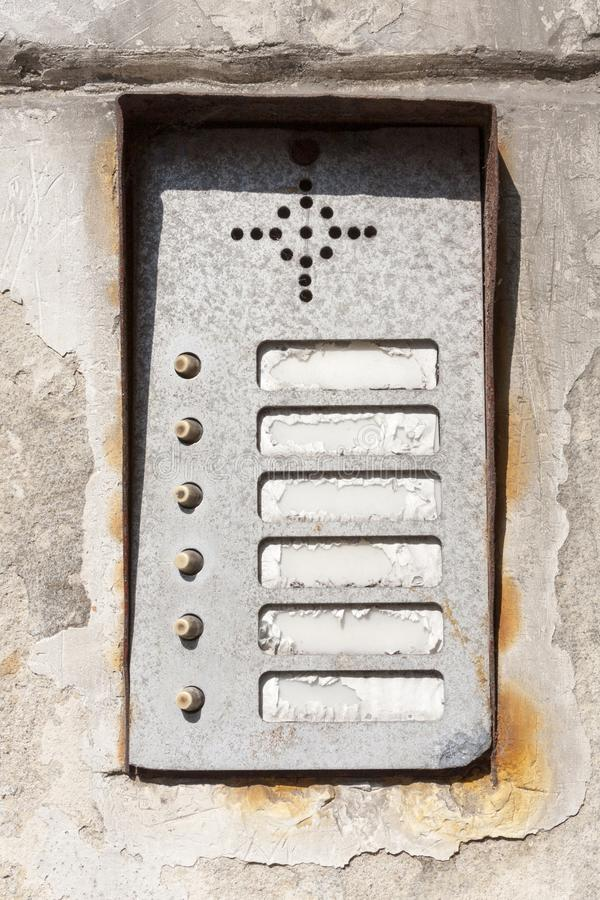 Old damaged worn vintage rusty apartment entry phone / Intercom panel with buttons high quality texture asset. Game texture grunge. Post apocalytpic assets royalty free stock photography