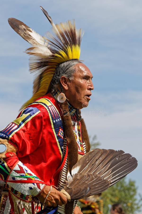 An old dancer at the 49th annual United Tribes Pow Wow of Bismark. BISMARK, NORTH DAKOTA, September 8, 2018 : A dancer of the 49th annual United Tribes Pow Wow royalty free stock photography