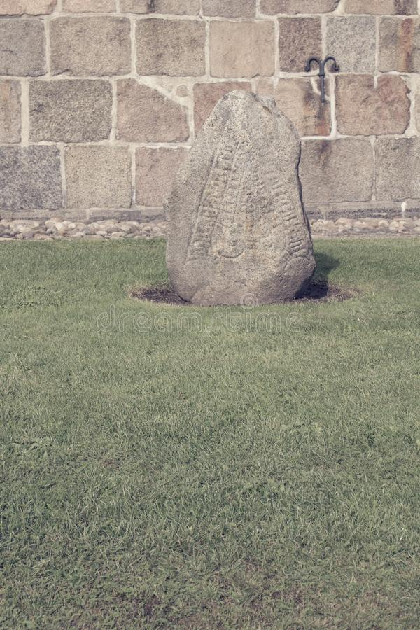 The old Danish Rune Stone. Shot at Aarre Church in Denmark royalty free stock photography