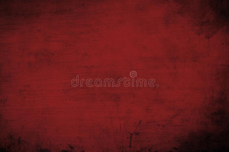 Dark red abstract background or texture. Old dark red distressed wall background or texture with dark vignette borders royalty free stock photo