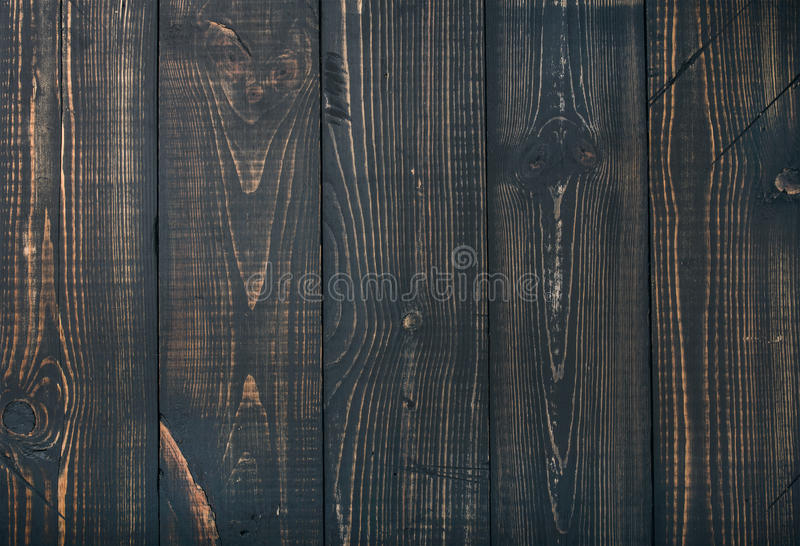 Old dark scorched wood texture, wallpaper or background stock images