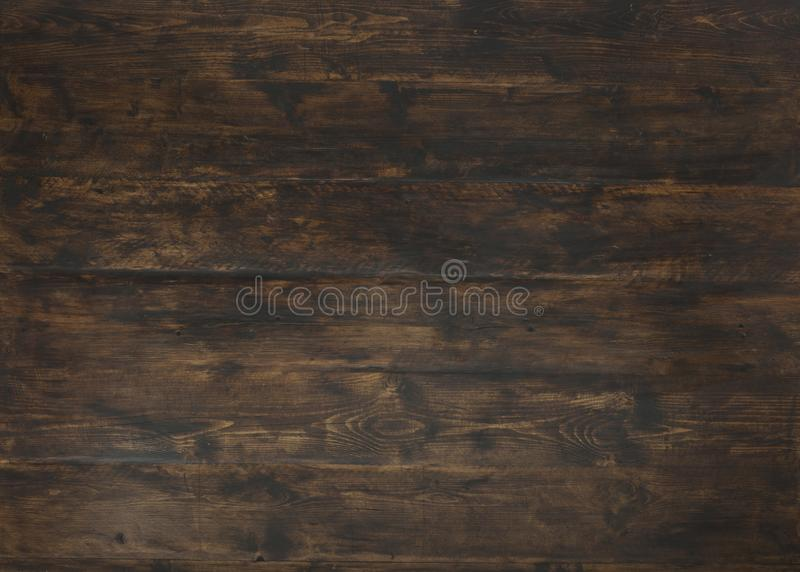 Old dark textured wooden background, brown wood stained style royalty free stock photography