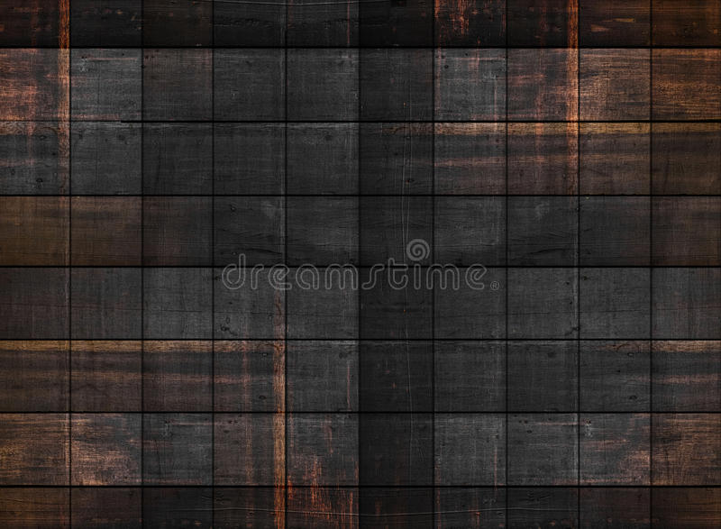 Old dark wood texture with square patterns royalty free stock photo