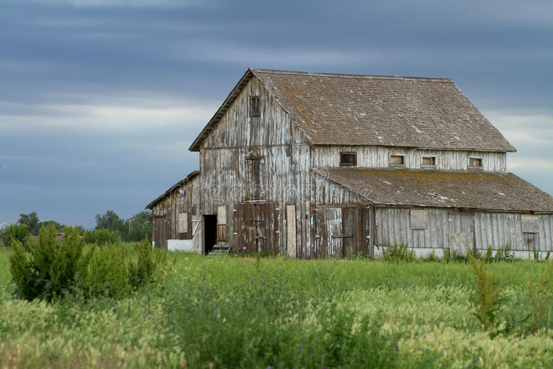 Old Decaying Barn against a Cloudy Sky stock images