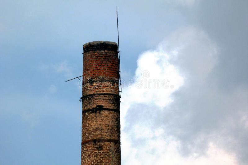 Old decaying tall brick chimney detail abstract stock photos