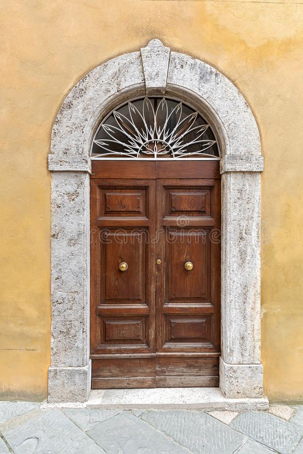 Old decorated door. On the building facade, Italy stock images