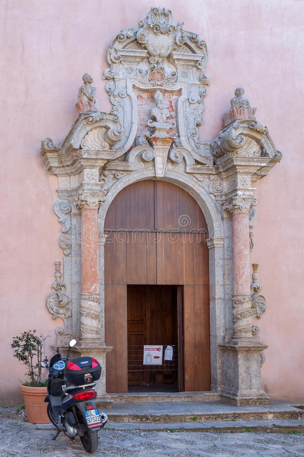 Old decorative door of a church in Erice, Sicily stock images