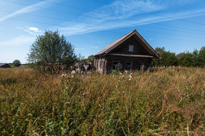 Old decrepit wooden house in a Russian remote village at summer. Nature. stock images