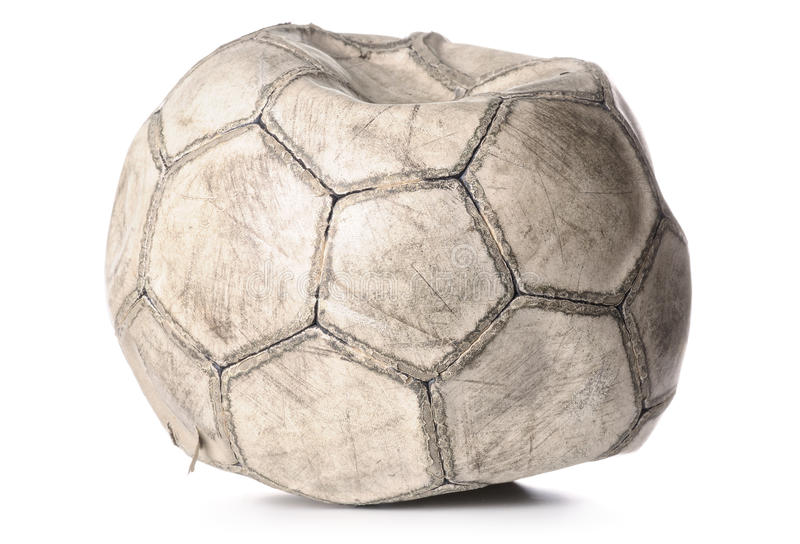 Old deflated soccer ball stock images