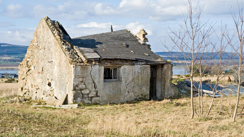 Old derelict crumbling cottage. An image of a dilapidated cottage by the sea and in the final stages of decay. Such a building is still of substantial value as stock photos