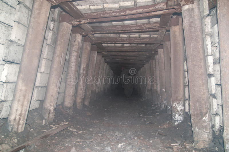 Old derelict mine. Old abandoned coal mine tunnel stock images