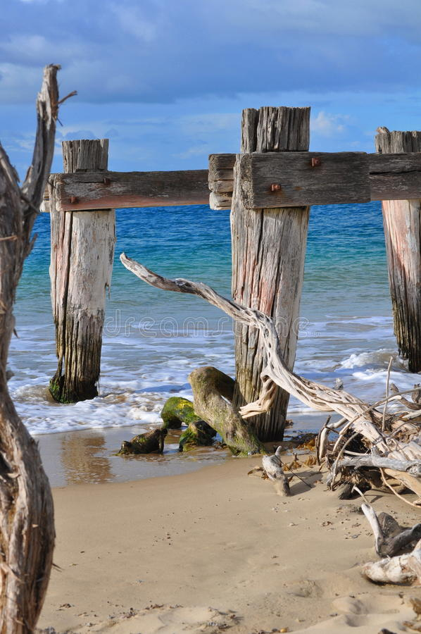 Old destroyed pier. At Australia coast royalty free stock photos