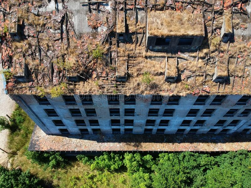 Old destroyed and ruined industrial building, aerial view royalty free stock image