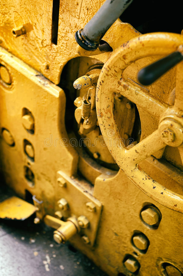 Old devices for driving engine. Old abandoned industrial engine that was used in mining industry in the past. Detail of devices for driving inside cab royalty free stock photos