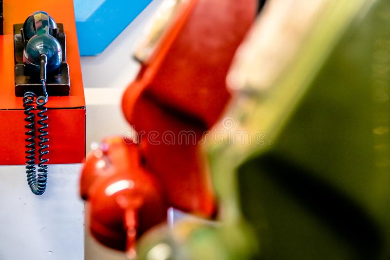 Old dial analogue colourful telephones. Old technology- dial analogue colourful telephones royalty free stock image