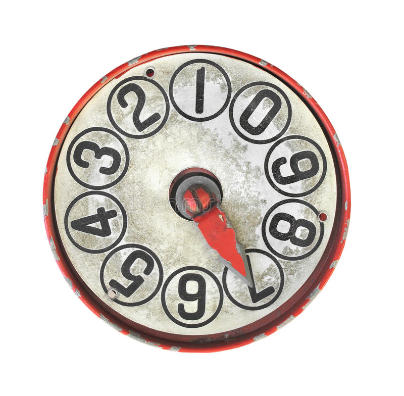 Old dial gauge isolated. Old and worn dial gauge with numbers. Isolated on white royalty free stock photos