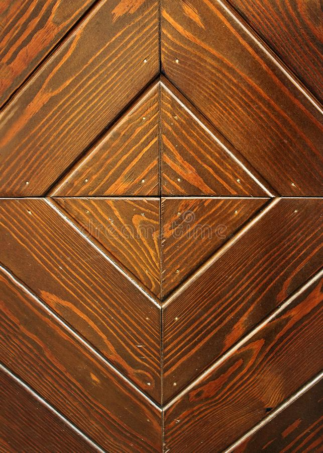 Old diamond shaped wooden door texture background stock image
