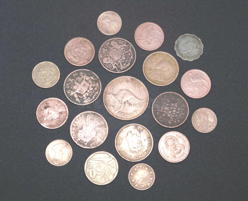 Old Coins isolated on black background stock photography