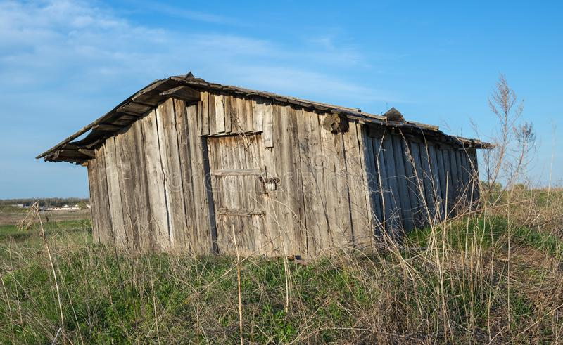 Old dilapidated barn. In the field royalty free stock image
