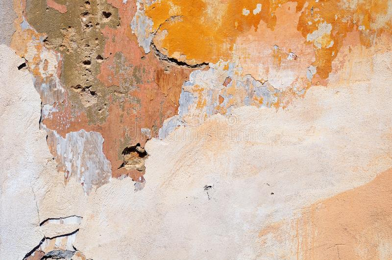 Old dilapidated plastered stone wall royalty free stock photo