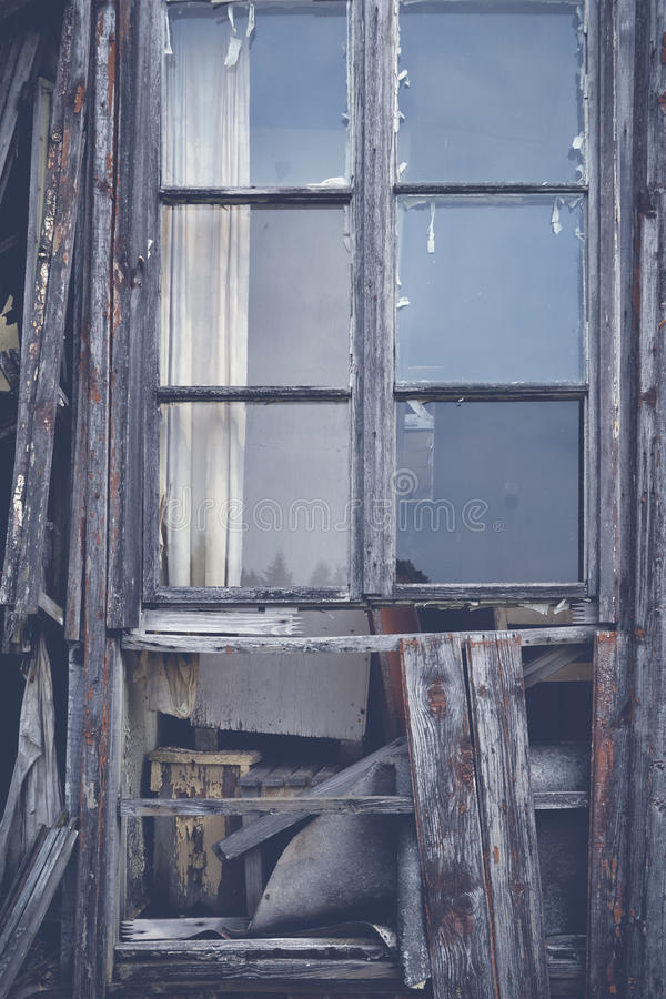 Old dilapidated wooden windows. Old destroyed dilapidated wooden window royalty free stock photos