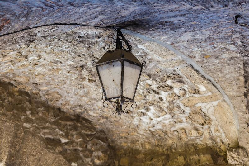 Old lamp. Old and dirt lamp in Italy royalty free stock photos