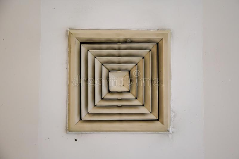 Old and dirty air duct vent hole fan on ceiling in building ventilation system stock photos