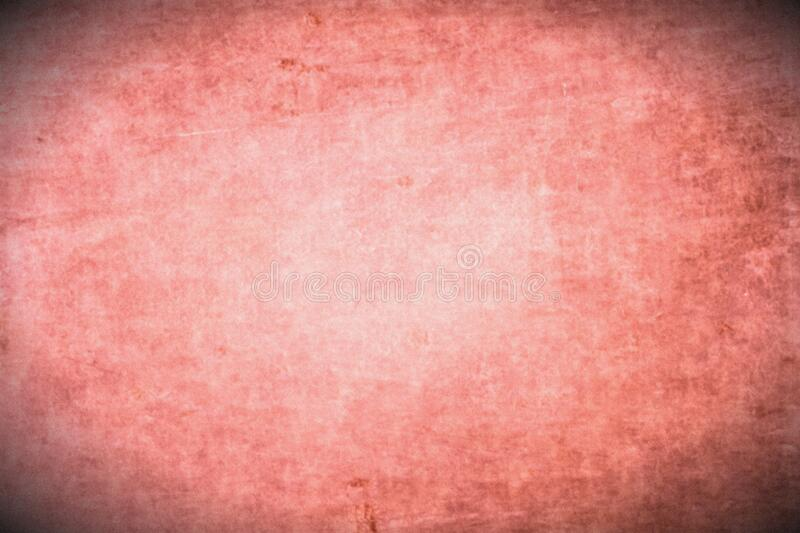 Old dirty antique paper texture background with light centre and dark corners. Pink orange colour background with vignette. stock image