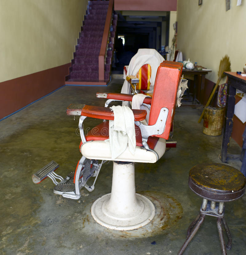 Old and dirty barber chair stock photos