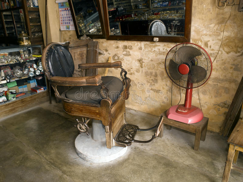 Old and dirty barber chair royalty free stock images