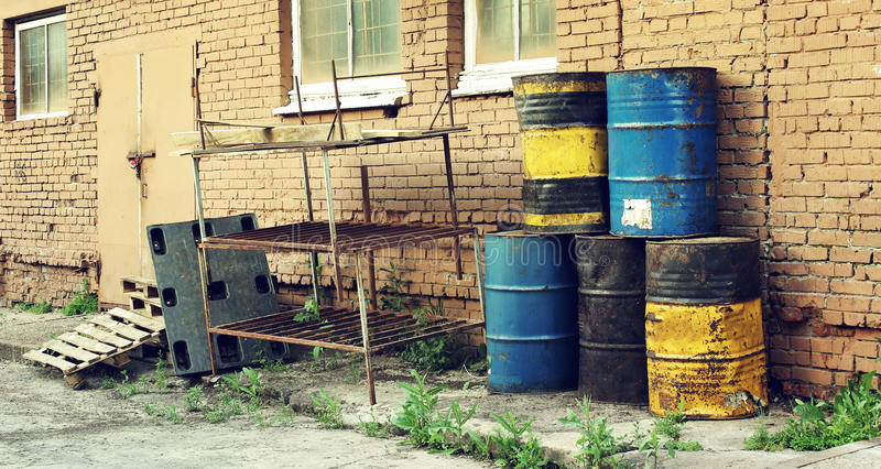 Old dirty barrels of oil under. In the industrial zone stock image