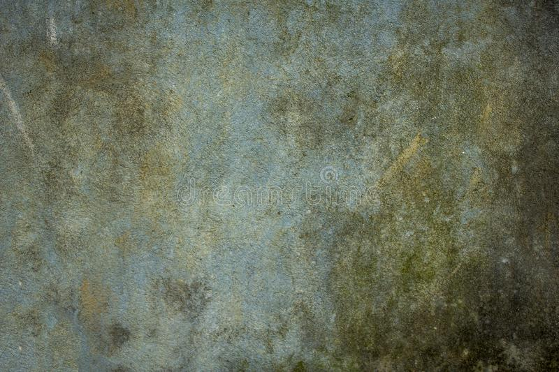 Old dirty blue-green wall with scratches and stains of dirt, mold and moss. rough texture. rough concrete wall royalty free stock images