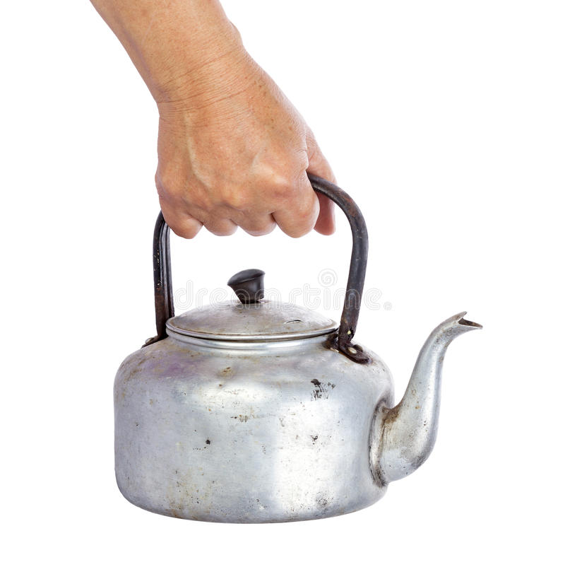 Old dirty classic aluminum kettle holding in hand isolated on wh. Ite background royalty free stock photo