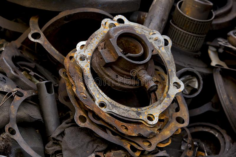 Old dirty gasket is dumped. The old dirty gasket was dropped, being pulled out of the engine stock images
