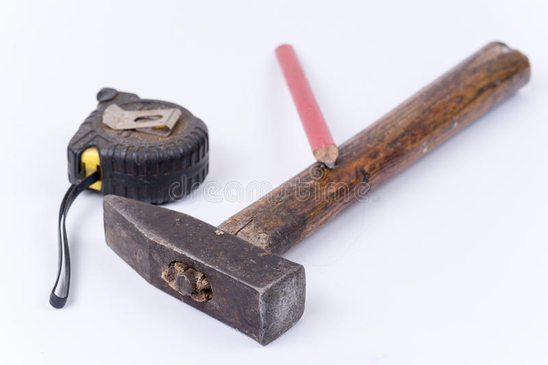 Old dirty hammer meter and wooden pen stock image