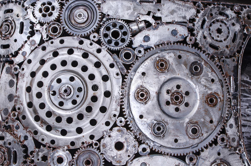 Old and dirty metal wheel gear weld background stock image