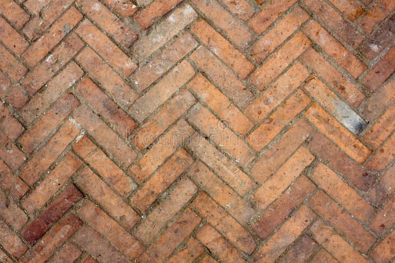A old dirty red brick parquet. rough surface texture. parquet with stains of paint and dirt. Old dirty red brick parquet. rough surface texture. parquet with stock photos