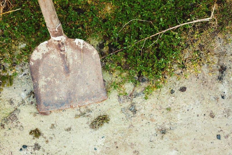 Old Dirty Shovel on Asphalt stock photo