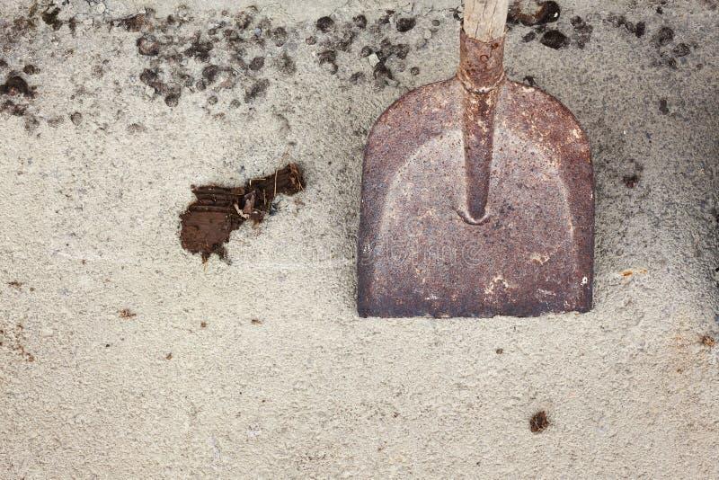 Old Dirty Shovel on Asphalt stock photos