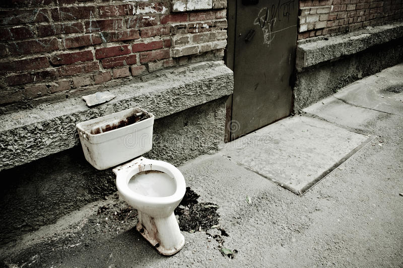 Old dirty toilet royalty free stock photography