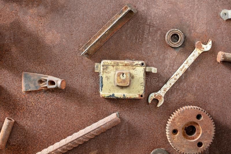Old, dirty tools against rusty metallic surface Tool series. royalty free stock photo