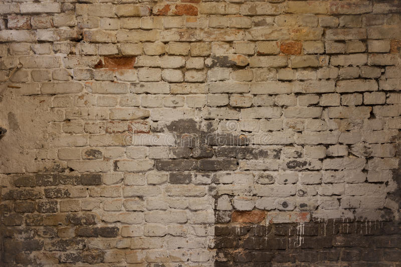 Old dirty weathered brick wall with chalk paint remains stock images