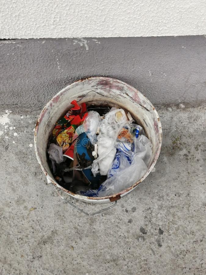 Old dirty white bucket with garbage stock photos