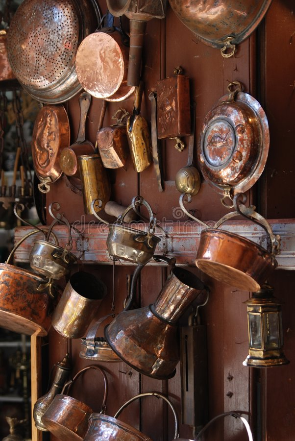 Old dishware. Obsolete copper utensils. Retro style royalty free stock photos