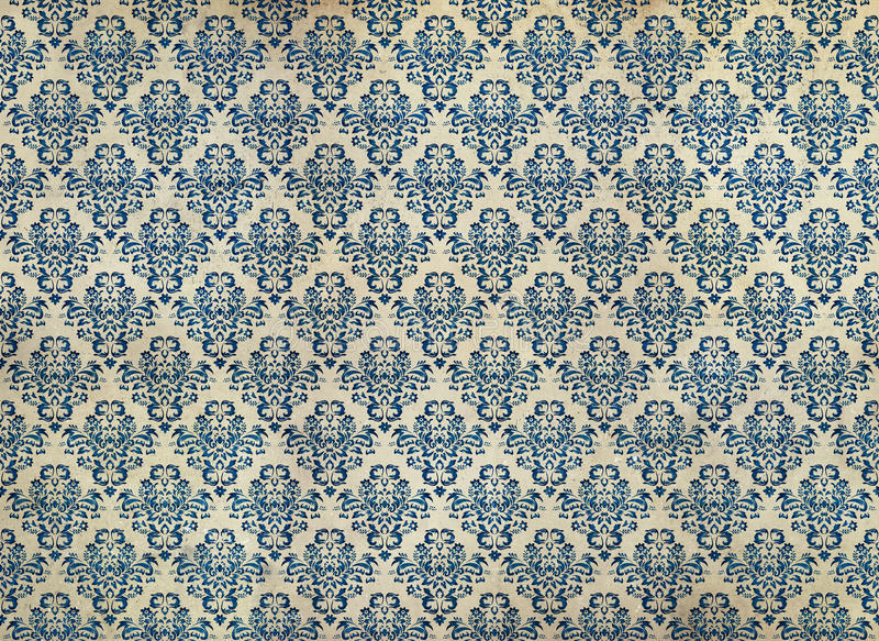 Old distressed blue damask wallpaper. Old, worn and distressed wallpaper stock image